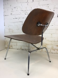 """Pair of Walnut LCM chairs by Ray and Charles Eames, manufactured by Evans Products Company, prior to Herman Miller which took over in later years - highly collectible - """"a Rare find """" in usable condition, but have seen some wear and tear.. shock mounts on the back have been re-glued and one point also the wood could use re-finishing or perhaps you like the worn look - we will leave that up to you -if you've ever sat on one of these chair you know they are very comfortable - (SOLD)"""