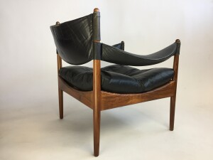 Gorgeous black leather and Rosewood armchair designed by Kristian Solmer Vedel, for Soren Willadsen - Made in Denmark circa 1963 - the leather is in very nice vintage condition and the rosewood frame has been newly refinished and looks incredible - a RARE find - check out our other postings of a matching chair and a matching side table