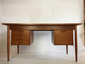 Handsome 1960s executive teak desk designed by Gunnar Tibergaard - Made in Denmark - perfect combination of 3 drawers on the left a file cabinet on the right and a center drawer :) - this beauty is finished on all sides so could be used in the middle of a room - newly refinished