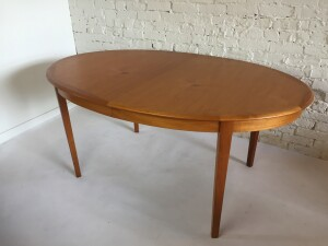 "Gorgeous Vintage teak oval shape dining table by Danish Compnay Dyrlund - quality craftsmanship - all wood - it comes with 2 leaves that are just slightly darker - fantastic solid teak trim and legs - very good vintage condition - a must see - 63"" x 41.5""D x 28.5""H fully extended - 103""L $1,300"