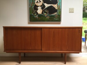 Handsome Vintage teak sideboard - Made in Denmark - lovely smaller size for compact living spaces - newly re-finished - adjustable shelving on either side and a small dovetailed drawer on the right -(SOLD)