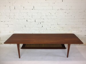 "Spectacular 1950's 2 tier teak coffee table by Danish designer's Peter Hvidt & Orla Molgaard-Nielsen for France & Daverkons comprised of a solid teak wood top - the 2nd tier is a fabulous mix of solid teak and cane with a floating appearance thanks too the solid brass hardware - - newly re-finished and ready for your home - 59""L x"
