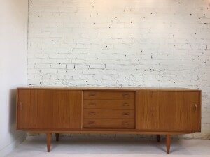 "Handsome Vintage teak sideboard by Danish Company Dyrlund - lovely dovetailed wood drawers, carved pulls with the classic tapered leg - * note the top has 2 dark spots where a hutch once sat - - overall fantastic condition - loads of storage - this beauty measures 82.25""L x 18""D x 29.5""H - fantastic price - $950"