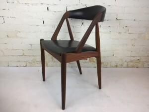 Gorgeous Pair of 1950's teak dining chairs designed by Kai Kristiansen -chair model 31 - Made in Denmark - newly refinished teak frames - very nice condition with the exception of one small nick in the naugahyde on one seat :) - (SOLD)
