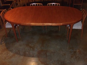 "Exceptional teak dining table designed by IB Kofod Larsen made in Denmark in the 1960's measures 67.5"" L X 42"" D X 29.5"" H as shown with its 20.75"" leaf (SOLD)"