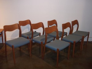Gorgeous set of 7 teak dining chairs designed by Niels Moller for famed Danish company J.L. Moller - company known for their outstanding quality - most coveted of the designs model 71 - newly restored with all new foam and re-upholstered in a fantastic quality Knoll fabric (light blue) - $3000