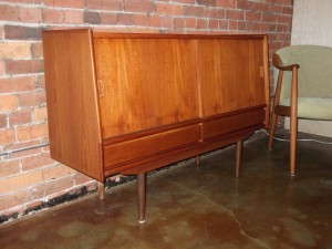 "Unique Mid-century modern small teak credenza - fantastic quality construction - great for small spaces - nice overall patina - *note the top left side has a dark patch** also right side has a couple dings - overall in fantastic vintage condition - 49""L x 14""D x 32""H - SOLD"