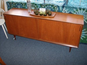 "Beautifully refinished Mid-century modern teak sideboard with 2 sliding doors and one drawer inside along with shelves on both sides - 65""L X15.5""D X28.5""H - (SOLD)"