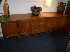 "Beautiful Mid-century modern 2 tone teak sideboard with lovely cupboards on either end, plus 4 beautifully dovetailed drawers in the center- lots of storage  - this piece also boasts a base that has the illusion of floating - NICE!! - Measurements: 7ft long X18""deep X31.25""high - (SOLD)"