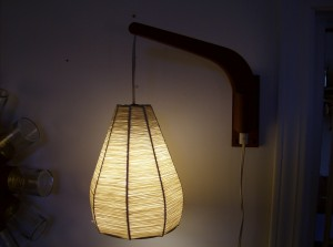 "1960's teak wall light with rafia shade - the arm can be swung from one side of the wall to the other - great for positioning wherever you need it to be - it measures 12"" from the wall to the end of the teak arm - (SOLD)"