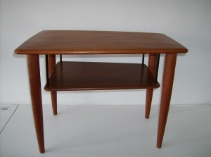 "Incredible Mid-century modern teak 2 tier end table - stunning design - the shelf appears as if it were floating - great vintage condition - Measurements - 26"" length X 19"" height X 18"" width that taper to 15"" -  SOLD (0 available)"
