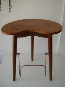 "Very unique (pretty rare)1950's Danish teak end table - this piece also has a place for magazines on the bottom, and a flip put tray that probably used to hold a pack of cigarettes back in the day - nice vintage condition -measurements - 15""L X 12""D X17""H  - (SOLD)"