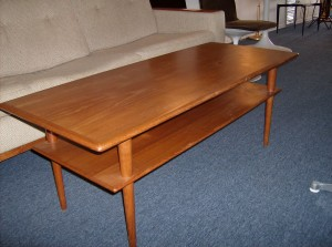 "1960's 2 tier teak coffee table - fantastic design/ super quality and super functional - the condition is good - the top could probably use a little steel wool and some teak oil, but definately not necessary - this piece measures - 4ft long X 19.5"" wide by 17.5"" tall - (SOLD)"