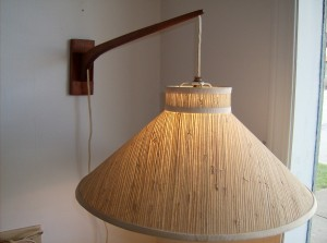 An incredible 1960's teak wall light - the arm moves with ease from side to side - these wall lights are perfect for any room in the house - over your favourite chair(for reading) -  bedside lights - on either side of your couch  - over your desk - many many uses - if you don't have alot of floor space they are a perfect solution - (SOLD)