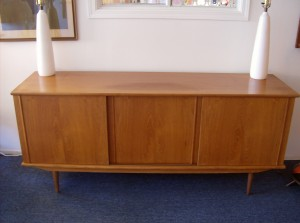"Handsome Mid-century modern teak sideboard - 3 sliding doors with loads of storage/ a couple drawers inside and shelves - this piece measures - 71"" X 19"" X 30""H - (SOLD)"