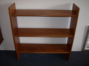 "This small Danish teak bookshelf is great on it's own, or can be added to other like pieces as part of a modular teak shelving unit - this piece measures - 31.5""L X 33""H X 9"" D - (SOLD)"