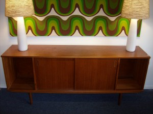 "Fantastic 1950's quality Danish teak sideboard - manufactured by Dyrlund - this peice has a beautiful dark rich patina and would look great in any Mid-century modern home and/or office, however there is one small flaw, it's not a huge deal for some folk,  but definately worth mentioning - this peice would have originally had 2 doors where it is open now... but we think it is fabulous as it is, but you be the judge - this peice measures 71.5 L X29.5""H X 16.5"" D - (SOLD)"