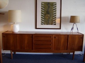 "Spectacular Mid-century modern teak sideboard - loads of storage in this beauty- sliding doors on either side with 4 drawers in the middle - this piece measures - 94.5""L X 19.25""D X 32""H - (SOLD)"