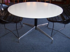 "Fantastic low occasional table - would be great on your patio with 4 solair lawn chairs - the top of the table is white melamine and the base made by Herman Miller & designed by Charles and Ray Eames - the table top diameter is 41.75"" and the height is 25"" - (SOLD)"