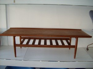 "Marvelous Danish teak 2 tier coffee table designed by Grete Jalk - the top could probably use a once over, as the finish is a little uneven, but overall what a beautiful piece - this piece measures  59""L X 22""D X 17""H - (SOLD)"