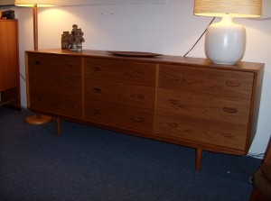 "1960's Danish teak 9 drawer dresser with lovely dovetailed drawers and beautifully carved pull - spectacular craftmanship - excellent condition - this piece measures 75.75""L X 18.5""D X 29.5""H - (SOLD)"