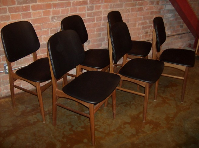 Spectacular set of 6  Danish teak dining chairs - excellent vintage condition - recently reupholstered in a textured black naugahyde - $1100/set